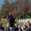 Prime Minister Abbott addresses guests; with Australia's Magna Carta Monument at the side